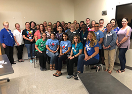 EMS ISD campus nurses and nurse's aides pose for a group picture.